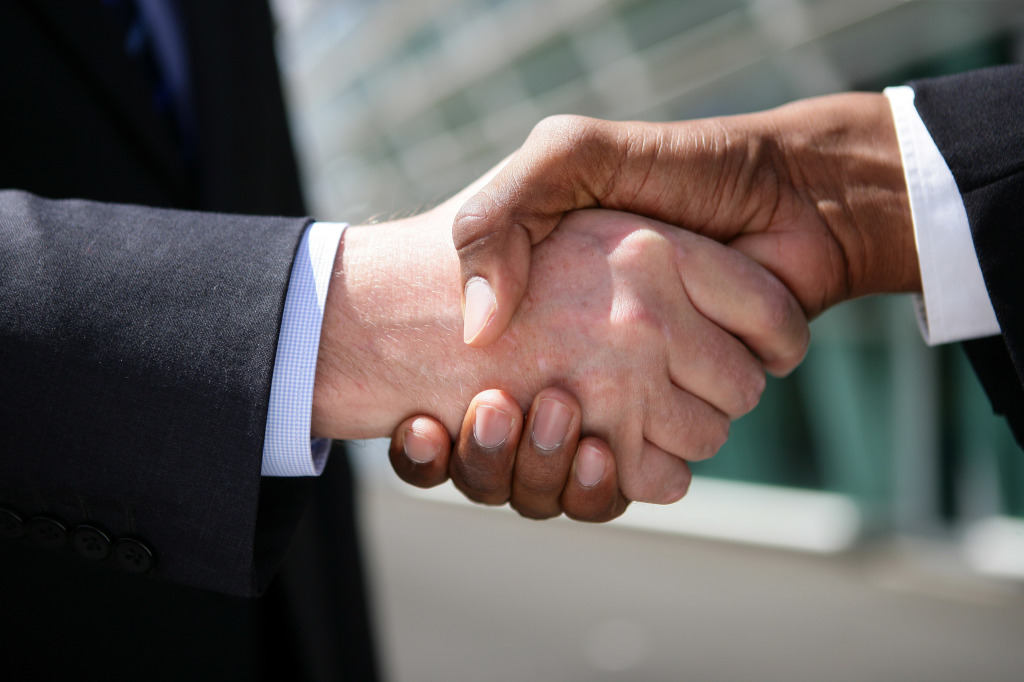businessmen-shaking-hands-outdoors